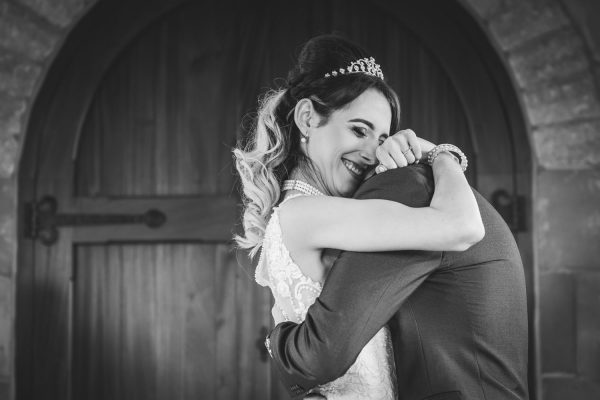 bride & groom hug after saying I Do