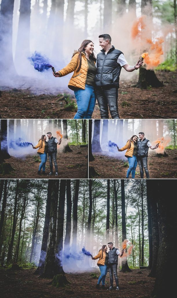 Engaged couple holding smoke bombs during a couples shoot at Beacon Fell